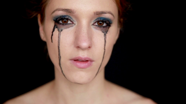crying-woman-with-mascara-running-under-her-eyes_s8fh3zx4g_thumbnail-full01