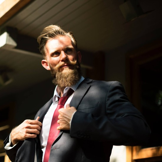 confident man with beard and tie