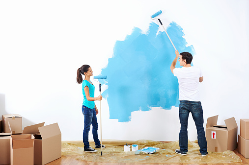 couple painting the wall